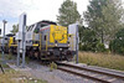 A train passes through a rail portal radiation monitor at the Port of Antwerp in Belgium, which participates in the U.S. Megaports Initiative. The Obama administration in this budget year has reduced spending by 85 percent for the program that deploys detection technology to prevent smuggling of nuclear and radiological materials through foreign seaports (U.S. National Nuclear Security Administration photo).