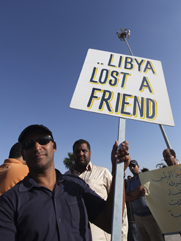 A Libyan peace protester is seen on Sept. 21 in Benghazi, 10 days after the militant attack that killed U.S. Ambassador Chris Stevens and three other Americans in the city. A new report lashes the State Department for failing to anticipate and prepare for the assault (AP Photo/Mohammad Hannon).
