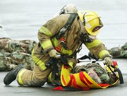 A firefighter treats a mock victim of a WMD attack during a 2004 response drill at the Pentagon. The United States is working to bring additional countries into a decade-old multilateral program to prevent the spread of weapons of mass destruction, a senior State Department official said on Thursday (AP Photo/Manuel Balce Ceneta).
