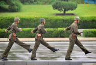 North Korean soldiers march during a September ceremony at the truce village of Panmunjom in the demilitarized zone along the border with South Korea. New satellite photographs suggest that Pyongyang is busily expanding its nuclear-materials production complex at Yongbyon (Jung Yeon-Je/AFP/Getty Images).