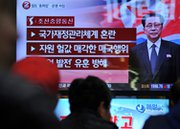 South Korean people at a Seoul railway station on Monday watch a news program about the alleged dismissal of Jang Song-Thaek, North Korean leader Kim Jong Un's uncle. Pyongyang confirmed that Jang had been ejected from power (Woohae Cho/AFP/Getty Images).