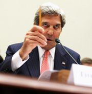 U.S. Secretary of State John Kerry, shown addressing the House Foreign Affairs Committee in September, is set to voice opposition to new Iran sanctions legislation when he testifies before the panel on Tuesday (Alex Wong/Getty Images).
