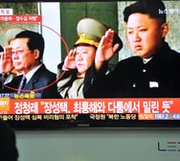 "Jang Song Thaek is shown in television footage standing to the far left of his nephew, North Korean ruler Kim Jong Un. Jang's recently announced ouster from power prompted South Korea's president on Tuesday to warn that Pyongyang is carrying out a destabilizing ""reign of terror"" (Jung Yeon-Je/AFP/Getty Images)."