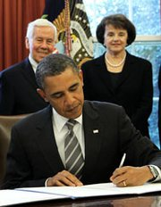 President Obama signs the New START arms reduction pact with Russia into law during a February 2011 Oval Office ceremony as then-Senator Richard Lugar (R-Ind.) and Senator Dianne Feinstein (D-Calif.) look on. Compromise legislation released this week does not restrict U.S. efforts to comply with the accord as much as some House Republicans had initially sought (Alex Wong/Getty Images).