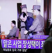 South Korean television news shows Jang Song Thaek in court before his announced execution on Thursday. The slaying of North Korean ruler Kim Jong Un's powerful uncle surprised many foreign observers, who are now concerned about stability in a country with nuclear-arms technology (Woohae Cho/AFP/Getty Images).