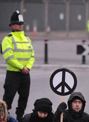 A British police officer guards the entrance to the Atomic Weapons Establishment in Aldermaston during a 2010 demonstration by peace activists. A number of British Defense Ministry law-enforcement personnel face allegations that they failed to complete their patrols at the AWE facility at Burghfield (Ben Stansall/AFP/Getty Images).