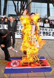 South Korean conservative activists burn an effigy of North Korean leader Kim Jong Un during a November rally in Seoul. Pyongyang is threatening to carry out surprise attacks on the South if such protests against North Korea are not ended (Jung Yeon-Je/AFP/Getty Images).