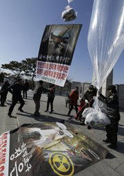 South Korean protesters and North Korean defectors release balloons loaded with anti-regime messages on Saturday near Seoul. U.S. scientists say the explosive yield of the North's latest nuclear test was more than two times as powerful as its previous blast in 2009 (AP Photo/Lee Jin-man).