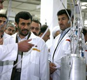 Iranian President Mahmoud Ahmadinejad listens to a technician while visiting his country's Natanz complex in 2008. Iran has begun installation of 180 next-generation uranium enrichment centrifuges at the site, the International Atomic Energy Agency said on Thursday (AP Photo/Iranian Presidency).