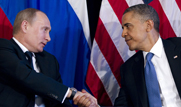 President Obama, on right, shakes hands with Russian President Vladimir Putin during a June 2012 meeting in Mexico. Obama could use his executive authority to promote nuclear arms reductions or missile defense compromise with Russia absent approval from Congress, experts said (AP Photo/Carolyn Kaster).