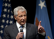 Chuck Hagel speaks at the Pentagon on Wednesday after being sworn in as U.S. Defense secretary. Hagel said the Defense Department would act to implement mandated spending cuts set to take effect on March 1 (AP Photo/Cliff Owen).