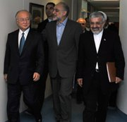 International Atomic Energy Agency Yukiya Amano, left, seen with Iranian officials in 2011. Tehran rejected press claims that its past work with polonium 210 would be discussed in upcoming talks with Amano's organization.