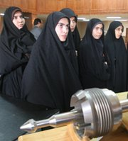 Women listen to a presentation at a 2006 Iranian Atomic Energy Organization exhibition in the city of Qum. A number of experts have warned that hardening Iranian and U.S. political positions could make common ground harder to find in nuclear negotiations scheduled to start this month.