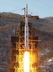 North Korea's Unha 3 space rocket lifts off in December 2012, in an image released by official state media. Recent satellite images of the country's Dochang-ri missile site indicate work is almost finished on a tower big enough to handle rockets larger than the one Pyongyang successfully launched into space more than a year ago.