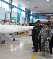 Iranian officials examine air-defense missiles in November. Iran's defense minister on Monday said the nation had successfully tested two new missiles.