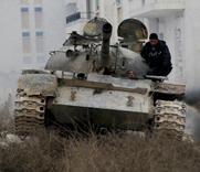Syrian opposition fighters drive a tank during Monday clashes with government forces on the outskirts of Aleppo. Damascus intends to finish relinquishing its most lethal warfare chemicals by March 1, according to a government envoy.