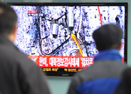 South Korean passengers at a Seoul train station watch television coverage of North Korea's third nuclear test on February 12, 2013. New satellite images show a marked uptick in the pace of digging of a new tunnel at the North's Punggye-ri nuclear testing grounds, an image expert said on Thursday.