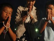A mother and her children in Hiroshima, Japan, pray for atomic bomb victims on Aug. 6, 2013, the 68th anniversary of the U.S. bombing of the city. Nations supporting nuclear disarmament could unite this year in demanding a deadline date to start formal talks on a treaty that would ban all nuclear weapons.