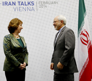 EU foreign policy chief Catherine Ashton stands on Tuesday with Iranian Foreign Minister Mohammad Javad Zarif in Vienna, the host city of this week's multilateral meeting on Iran's disputed nuclear activities.