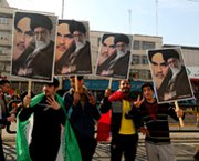 Demonstrators hold posters depicting Iranian supreme leader Ayatollah Ali Khamenei during a rally last week in Tehran's Azadi Square. Khamenei on Wednesday ordered his country to institute economic reforms aimed at curbing the effect of international sanctions targeting its nuclear program.