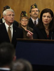 U.S. Senator Kelly Ayotte (R-N.H.), right, speaks at a December news conference with Senator Roger Wicker (R-Miss), left. The two lawmakers want to know whether a White House nominee to a key Pentagon position knew of alleged Russian violations of a 1980s arms control pact when he was lobbying the Senate to approve the New START accord in 2010.