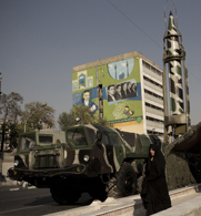 A woman passes a Shahab 2 ballistic missile on display in Tehran in 2010. Iran and the United States reportedly are still divided about whether a planned nuclear dialogue should address Tehran's ballistic-missile activities.