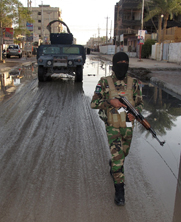 An Iraqi tribesman patrols a street as part of a January operation against anti-government fighters in the city of Ramadi. Iraqi politicians gave conflicting statements this week on their country's alleged purchase of $195 million in arms and ammunition from Iran.