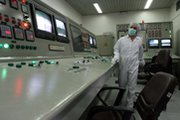 A technician is shown at Iran's Isfahan uranium conversion plant in 2007. A group of experts in a report issued on Monday pressed Washington to weigh action aimed at cutting off all international business with the nation over its disputed nuclear activities (AP Photo/Vahid Salemi).