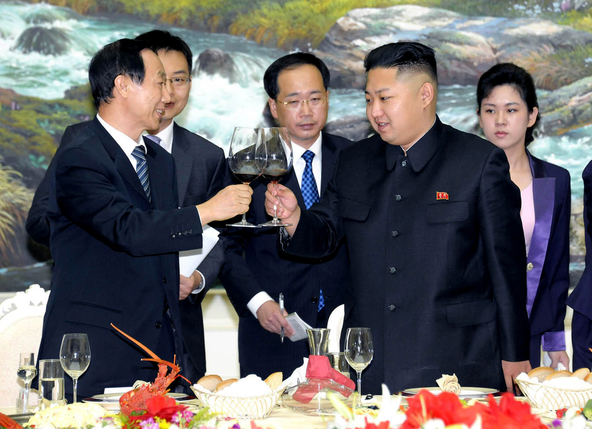 North Korean ruler Kim Jong Un, second from right, lifts a glass with Chinese Communist Party International Department head Wang Jiarui in August 2012 in Pyongyang. A former senior U.S. negotiator on Tuesday said China has yet to sufficiently use its leverage to pressure the North to accept lasting denuclearization (AP Photo/Korean Central News Agency).