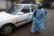 "A Vietnamese health worker applies disinfectant to a car in February 2012 near the site of a possible avian influenza outbreak among ducks in Ha Nam province. Scientists on Wednesday said they would end a self-imposed moratorium on bird flu ""gain-of-function"" research (AP Photo/Na Son Nguyen)."