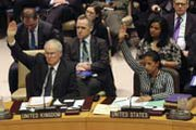 Envoys from the United Kingdom and United States on Tuesday vote for a U.N. Security Council resolution admonishing North Korea for its latest long-range rocket launch (AP Photo/Mary Altaffer).