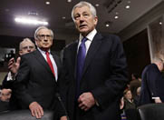 Former Republican Senator Chuck Hagel arrives on Thursday for a Senate Armed Services Committee hearing on his nomination as Defense secretary. Republican committee members pressed Hagel on his past positions on U.S. nuclear reductions and dealing with Iran (AP Photo/Scott Applewhite).