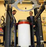 Then-U.S. Energy Secretary Steven Chu in 2011 receives an overview of the B-83 gravity bomb tooling system from National Nuclear Security Administration Production Office Manager Steve Erhart. A draft House-Senate congressional spending bill would increase by almost $1 billion NNSA weapons funding in fiscal 2014.