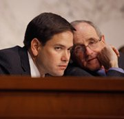 Senator Marco Rubio (R-Fla.), left, confers with Senator James Risch (R-Idaho) during a 2012 Senate Foreign Relations Committee confirmation hearing. The lawmakers asked to delay panel votes scheduled for this week on approving two State Department arms-control appointments.