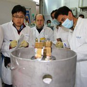 International Atomic Energy Agency inspectors and Iranian technicians on Monday disconnect links between twin centrifuge cascades for 20 percent uranium enrichment at Iran's Natanz facility. Iran would need to take substantial additional actions in any longer-term nuclear deal with world powers, according to a new analysis.