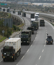 German military trucks on Tuesday transport Patriot air and missile defense systems from the Turkish port city of Iskenderun. The NATO military alliance is moving to deploy Patriot batteries in Turkey as a precautionary defense against ballistic missiles and other airborne threats from Syria (AP Photo/Burhan Ozbilici).