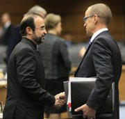 Iranian Ambassador to the International Atomic Energy Agency Reza Najafi, left, shakes hands in November with IAEA safeguards chief Tero Varjoranta.