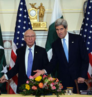 U.S. Secretary of State John Kerry and Pakistani national security and foreign affairs adviser Sartaj Aziz arrive at a ministerial-level meeting at the State Department in Washington on Monday. Diplomats from the two nations will meet in March to discuss new cooperation on countering terrorism.