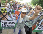 An activist takes part in an anti-North Korea demonstration last year in Seoul. U.S. National Intelligence Director James Clapper on Wednesday backed independent reports that Pyongyang appears to have restarted a reactor capable of producing nuclear-weapon plutonium.
