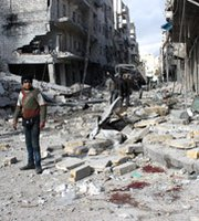 Syrians stand in a destroyed street in the city of Aleppo on Tuesday, following a reported airstrike by government forces. Damascus is capable of moving its chemical arms out of Syria faster than the operation is proceeding, U.N. Secretary General Ban Ki-moon said this week.