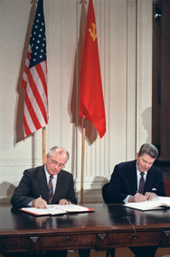 Then-Soviet leader Mikhail Gorbachev, left, and U.S. President Ronald Reagan sign the Intermediate-Range Nuclear Forces Treaty at a December 1987 summit in Washington. The United States reportedly has briefed NATO officials that Russia's recent testing of a cruise missile may have breached the accord.