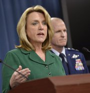 Air Force Secretary Deborah Lee James briefs reporters as Global Strike Command head Lt. Gen. Stephen Wilson looks on at the Pentagon on Thursday. The Air Force leaders said a climate of fear led a number of nuclear missile officers in Montana to cheat on a recent certification exam.