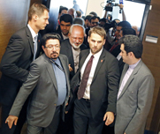 Iranian Foreign Minister Mohammad Javad Zarif, center, leaves a press conference after a multilateral nuclear meeting in Vienna last month. U.S. Secretary of State John Kerry on Monday urged Iran to take further action to rein in its disputed atomic efforts.