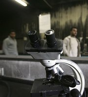 A damaged microscope seen in a Gaza Strip laboratory caught in crossfire between Palestinian fighters in 2007. An international panel said it is still impossible to fully determine how future technologies may make chemical-warfare materials easier to produce and harder to regulate.
