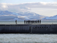 British Navy personnel stand atop a Trident nuclear-armed submarine, HMS Victorious, on patrol off the west coast of Scotland in April 2013. An independent U.K. panel on Tuesday said the nation might opt to put off a decision on how to modernize the fleet.