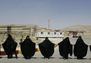 "Students form a chain around Iran's Isfahan uranium-conversion facility during a 2005 demonstration in support of the nation's nuclear program. Iranian Foreign Minister Mohammad Javad Zarif on Wednesday said Tehran would not ""kneel"" to other countries in negotiations on its nuclear program."