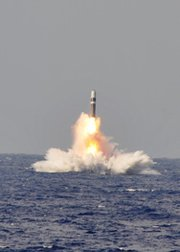 "A Trident D-5 ballistic missile is test-launched from the Ohio-class submarine USS West Virginia in the Atlantic Ocean in June. The U.S. Navy now says it would require an ""unsustainable level"" of funding to simultaneously build a successor ballistic missile submarine fleet and update its conventional forces."
