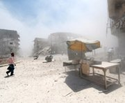 "People walk through dust after a reported Syrian government airstrike in the city of Aleppo on Monday. International authorities have authenticated sarin nerve agent allegedly ""abandoned"" in Syria, U.N. Secretary General Ban Ki-moon said in a letter last month."