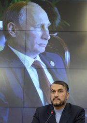 """Iranian Deputy Foreign Minister Hossein Amir Abdollahian attends a press conference in Moscow last week. French Foreign Minister Laurent Fabius said """"differences"""" have emerged between Russia and other nations participating in nuclear negotiations with Iran."""