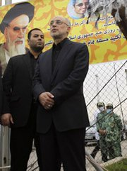 Iranian Atomic Energy Organization head Ali Akbar Salehi attends a rally last year outside Iran's Qum uranium-enrichment facility. Salehi said his nation would consider converting the site for other uses as part of a potential nuclear deal with six world powers.